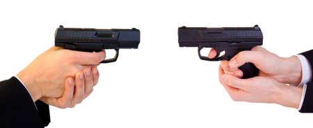 Aiming to each other with pistols photo