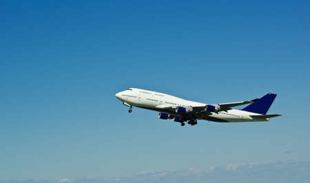 Flying jumbo jet shortly after take off