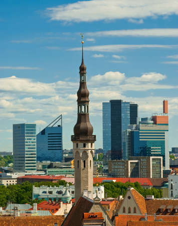 Tallinn city hall with skyscrapers on background photo