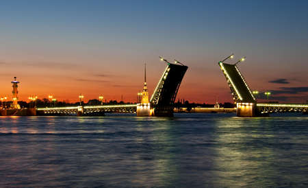 Raised Palace bridge at night in Saint-Petersburg, Russia Stock Photo
