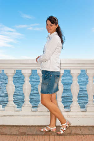 balustrades: Girl posing near the sea balustrades Stock Photo