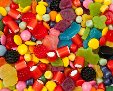 mixed colors: Different sorts of candies for background Stock Photo