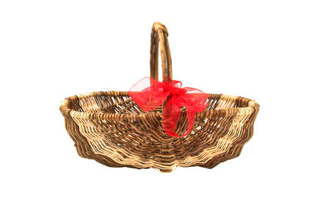 Wicker basket isolated on white photo