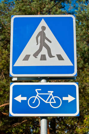 warns: Road sign warns about pedestrian crossing and bicycle road Stock Photo