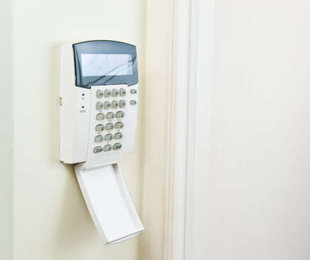 home security system: Alarm pad to secure the house Stock Photo