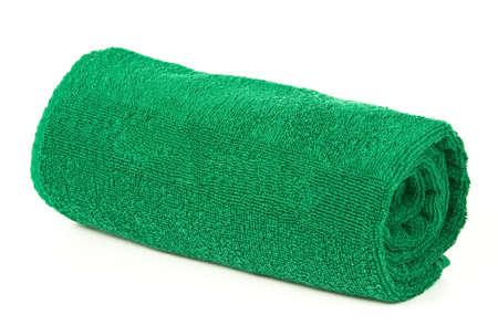 Green opgerolde handdoek op witte achtergrond Stockfoto