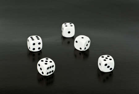 White dices over black background photo