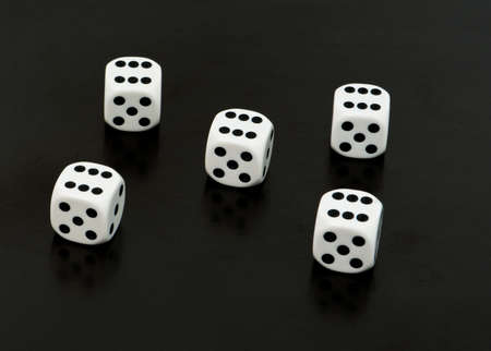 White dices with six on all of them photo
