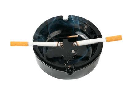lighten: Ashtray with smoking cigarettes over white