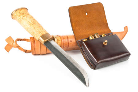 Knife and cartridge with ammo for hunting over white photo