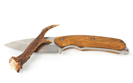 ramification: Knife and small antler horn over white Stock Photo