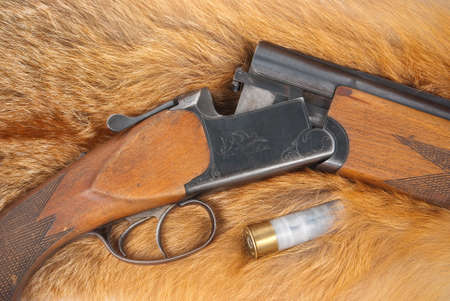 Shotgun with shell on fur photo