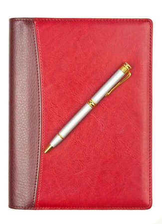 Diary with leather cover and pen isolated on white photo