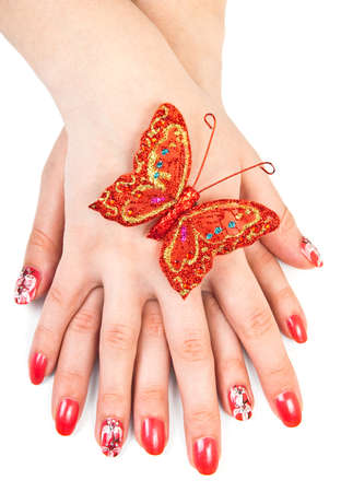 hand butterfly: Woman hands with red manicure over white Stock Photo