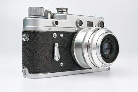 Old photo camera isolated on white photo