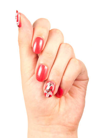 Womans hand with red manicured nails over white photo