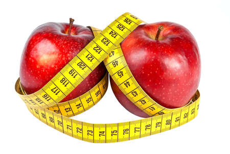 Delicious red apples with measuring tape photo