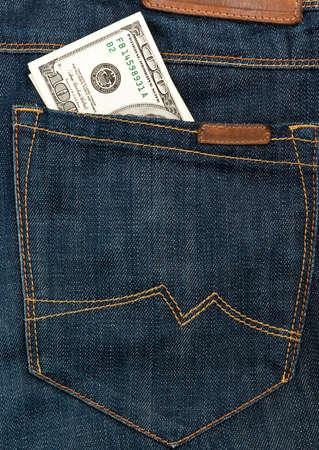 Amerikaanse dollars in jeanszak Stockfoto