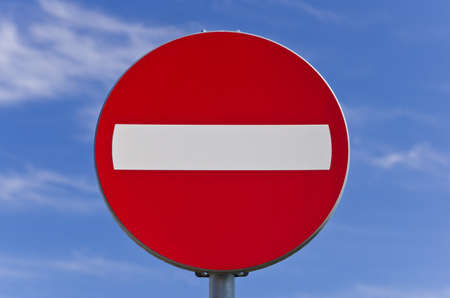 No entrance road sign over blue sky photo