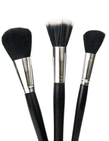 make up brushes: Make up brushes for powder isolated over white.