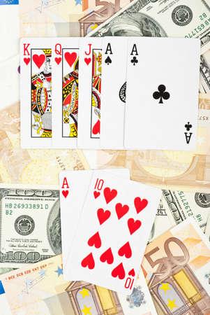 jack pot: Royal flash in poker game on heap of money