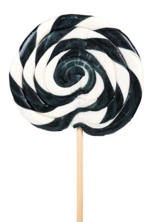 the lollipop: Big black and white lollipop on stick over white