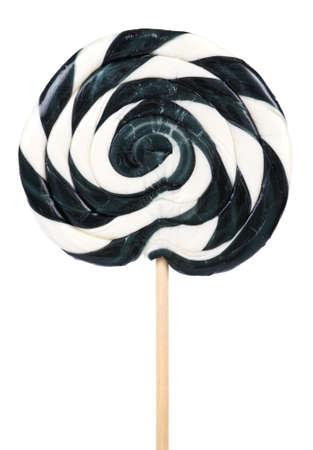paletas de caramelo: Negro grande y Lollipop blanco en el palo sobre fondo blanco Foto de archivo