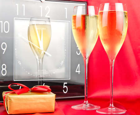 New year concept with sparkling whine, clock and gift. photo