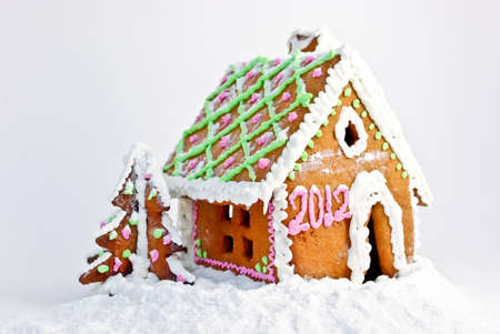 Gingerbread house with numbers 2012 to celebrate New Year photo
