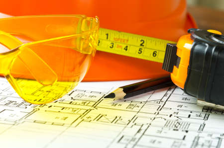 hardhat: Worker tools over blueprint close up. Stock Photo