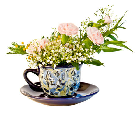 Bunch with dianthus in cup photo