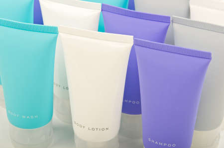 Body lotion, shampoo and conditioner in tubes photo