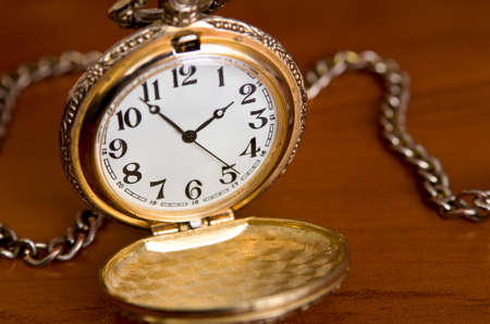 chronograph: Open pocket watch on table