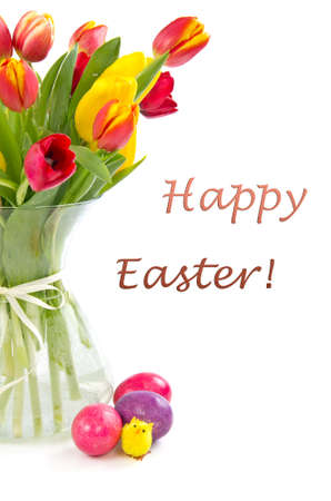 Tulips in vase and colored easter eggs.Happy easter greeting card. Standard-Bild