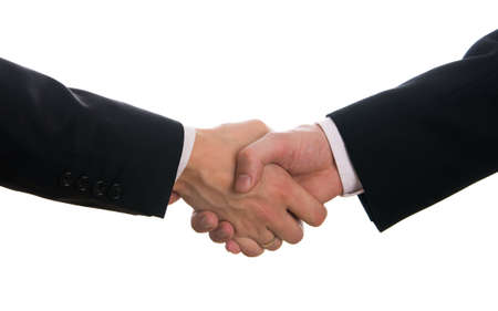 coalition: Businessmen shaking hands isolated on white