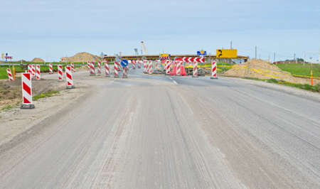 Roadsigns on road under construction. photo