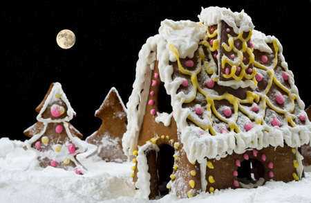 Christmas gingerbread house under starry heaven photo