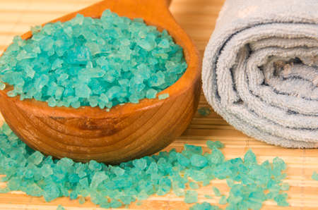 Blue bath salt in spoon and rolled towel Stock Photo - 16819286