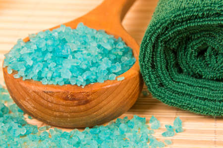 Blue bath salt in ladle and rolled towel Stock Photo - 16885270