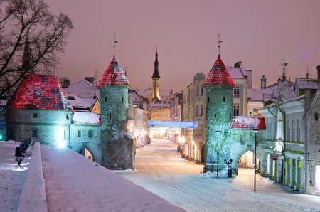 Snowy nighttime  old city of Tallinn, Estonia photo