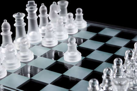 first move: First move with white glass pawn Stock Photo