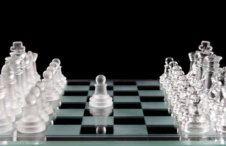 Glass white pawn made first move over black photo