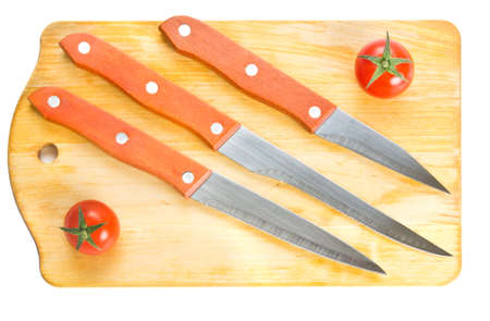 Kitchen knives on chopping board isolated on white photo