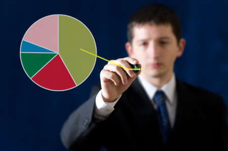 Young businessman drawing distribution diagram photo