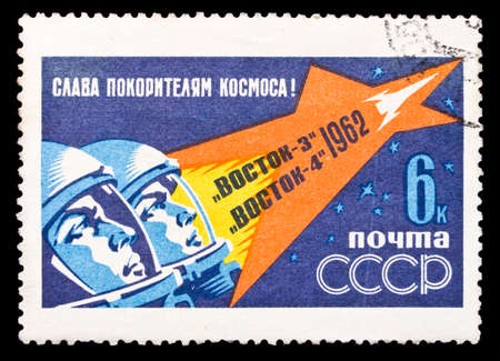 vostok: USSR- Circa 1962  USSR stamp dedicated to group space flight of spaceships  Vostok 3  and  Vostok 4  from series  First group space flight , circa 1962