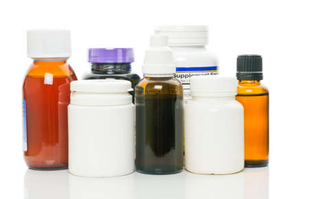 Bottles with medicine over white background