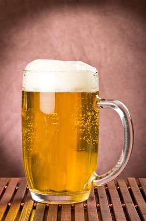 foamy: Golden foamy light beer in mug