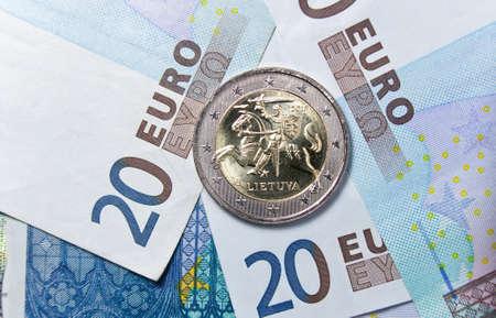 New Lithuanian 2 euro coin over euro banknotes photo