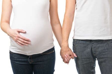 expectant arms: Pregnant woman and man holding hands isolated on white