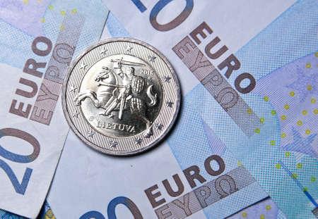 european exchange: 2 euro coin of Lithuania over euro banknotes Stock Photo
